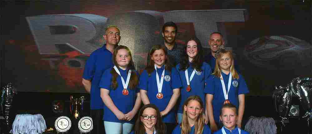 Woking Cougars Receive Medals From Former England Goal Keeper David James